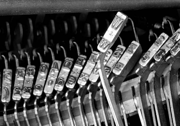 W hammers for writing with an ancient manual typewriter W hammers for writing with an ancient manual typewriter letter w stock pictures, royalty-free photos & images