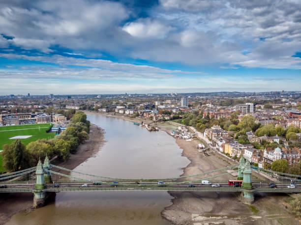 Hammersmith bridge at low tide, London, UK stock photo