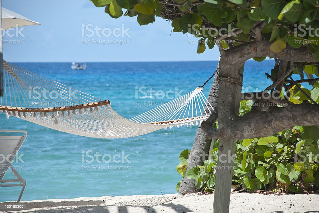 Hammock and blue water on Grand Cayman beach stock photo