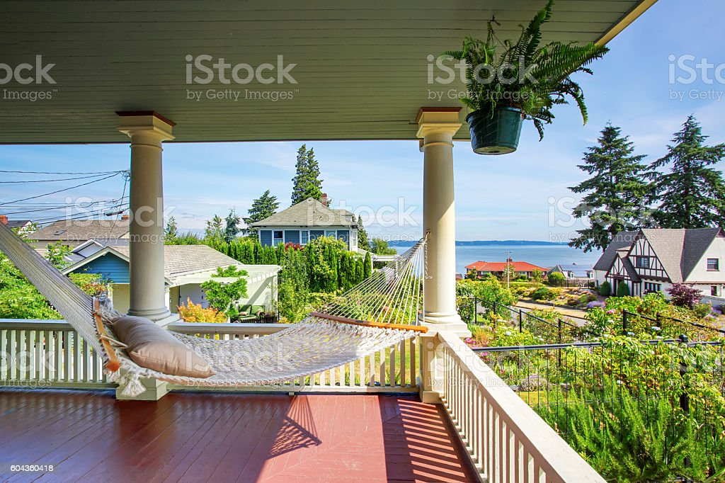 Hammock at the wooden walkout porch of craftsman American house stock photo