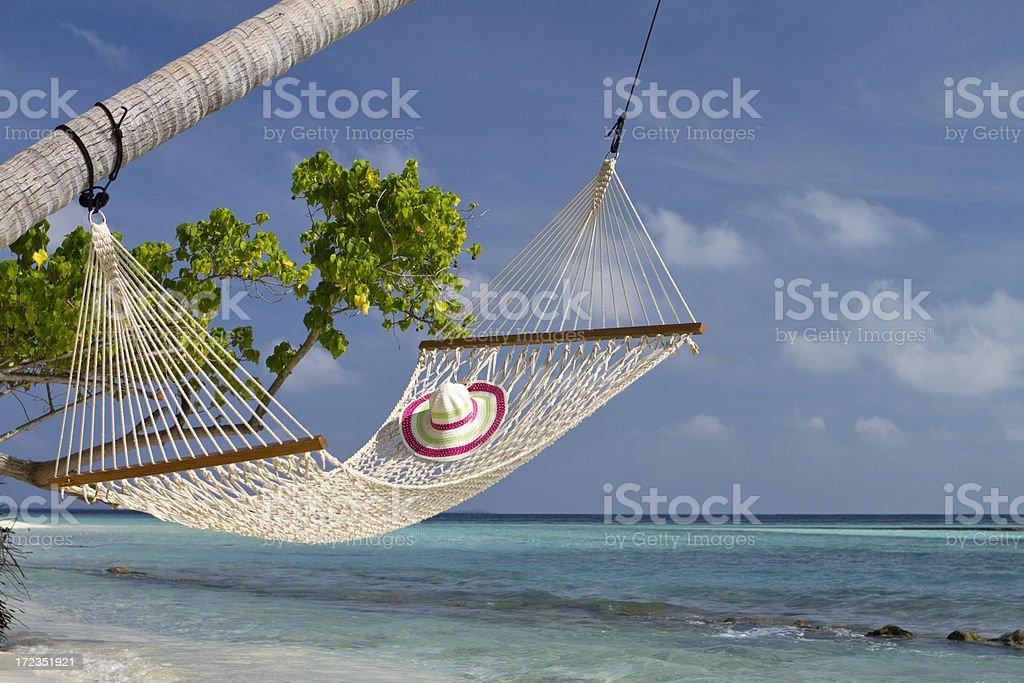 Hammock hanged on coconut tree by the sea royalty-free stock photo