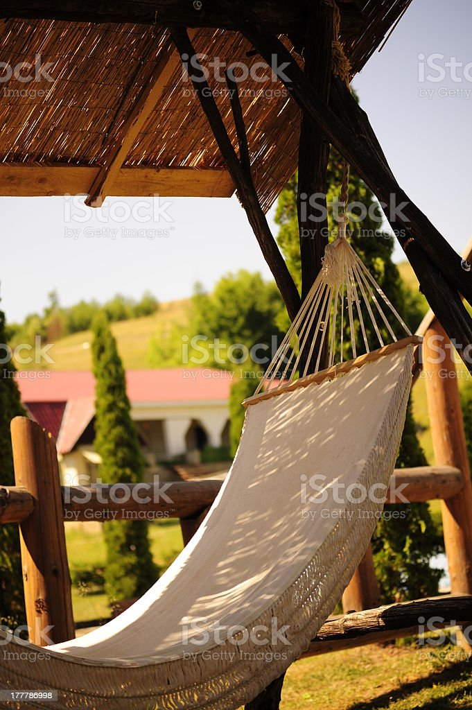 Hammock in the shade, on front lawn royalty-free stock photo