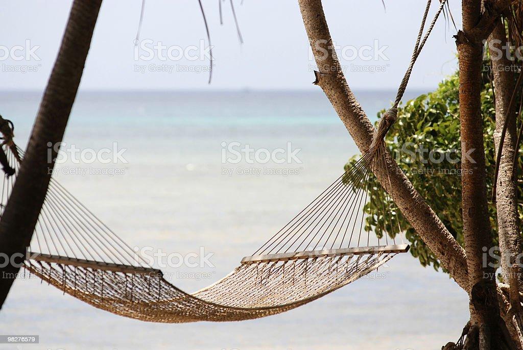 hammock on beach side royalty-free stock photo