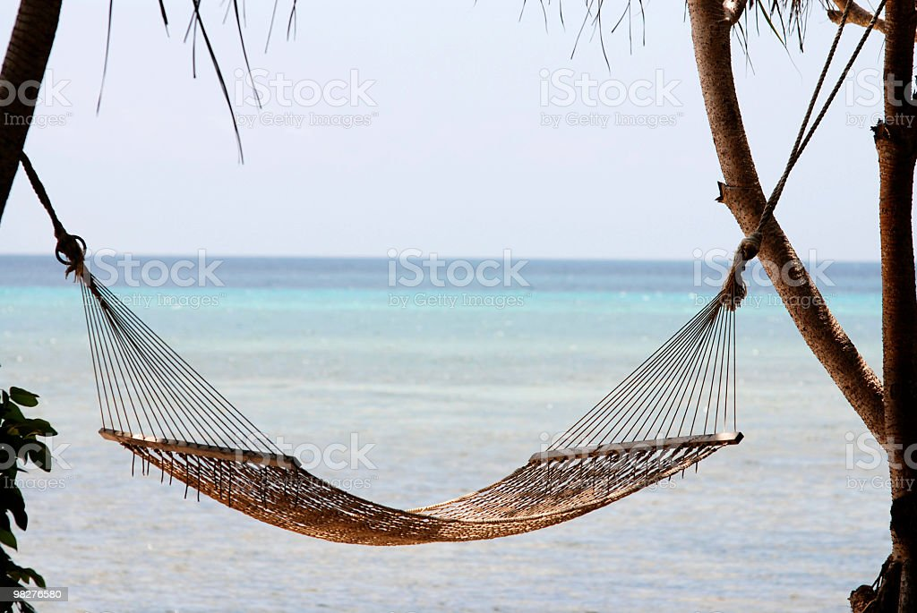 hammock on tropical beach royalty-free stock photo