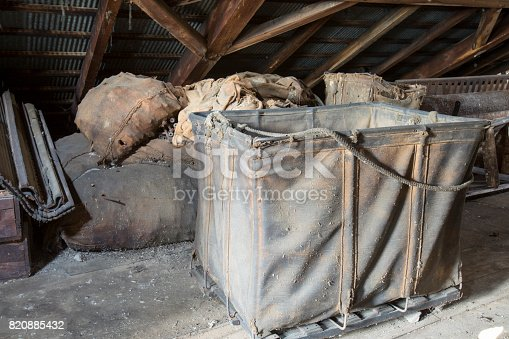 istock Hamper in dirty attic 820885432