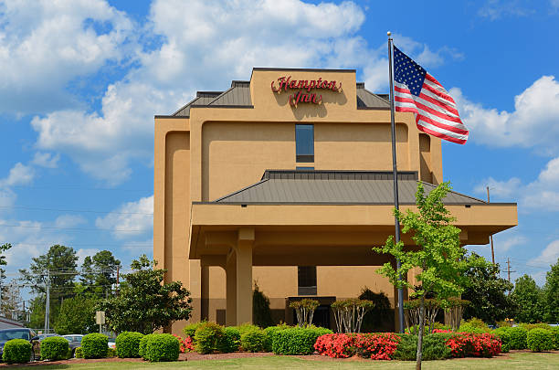 Hampton Inn Athens, USA - April 11, 2011: Hampton Inn is a chain of hotels trademarked and franchised by Hilton Worldwide which caters to the budget minded business and leisure traveler. inn stock pictures, royalty-free photos & images