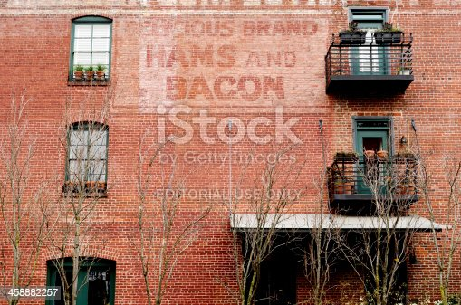Portland, USA -  March 9, 2013: A great old wall advertising sign in the Pearl District of downtown Portland Oregon, Delicious Brand Hams and Bacon, March 9th 2013
