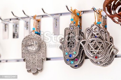 Hamsa amulets, middle-eastern good luck charm. Decorations of Israeli and jewish culture