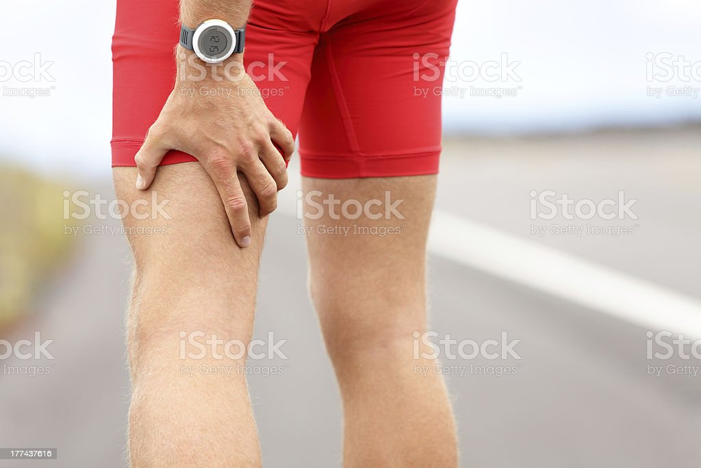 Hamstring sprain or cramps - Royalty-free Adult Stock Photo