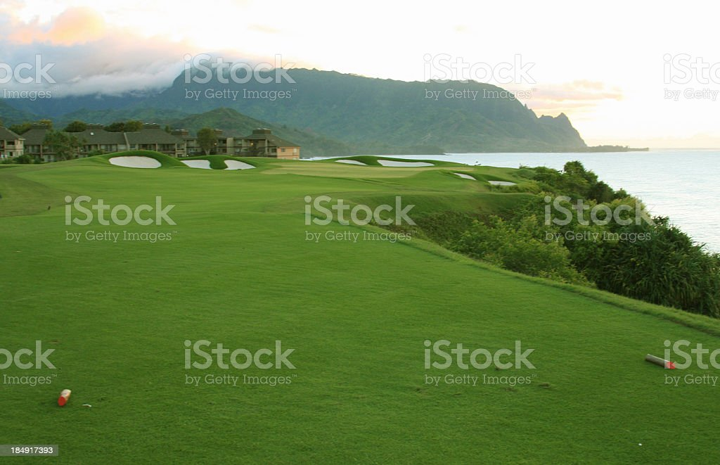 Hanalei bay Kauai resort hotel golf course at sunset stock photo