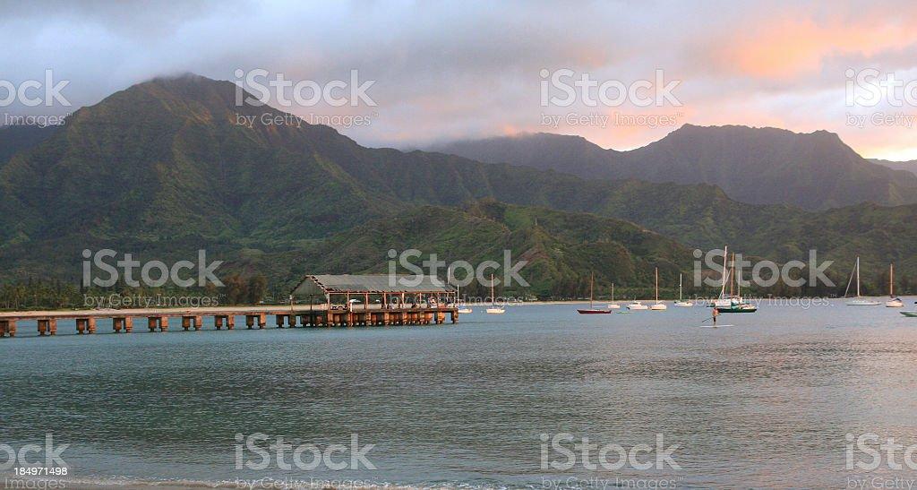 Hanalei bay pier Kauai sunset mountain beach scenic stock photo