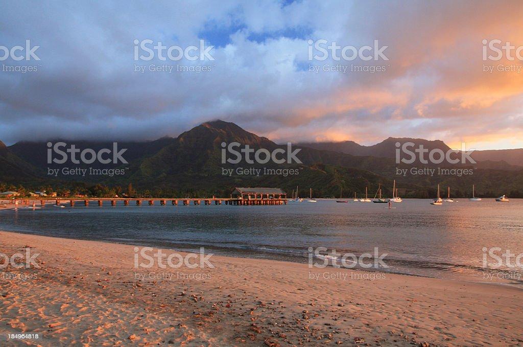 Hanalei pier Kauai Hawaii sunset mountain beach scenic stock photo