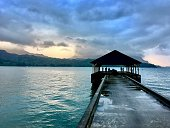 Watching the sunset on the pier in Hanalei Bay
