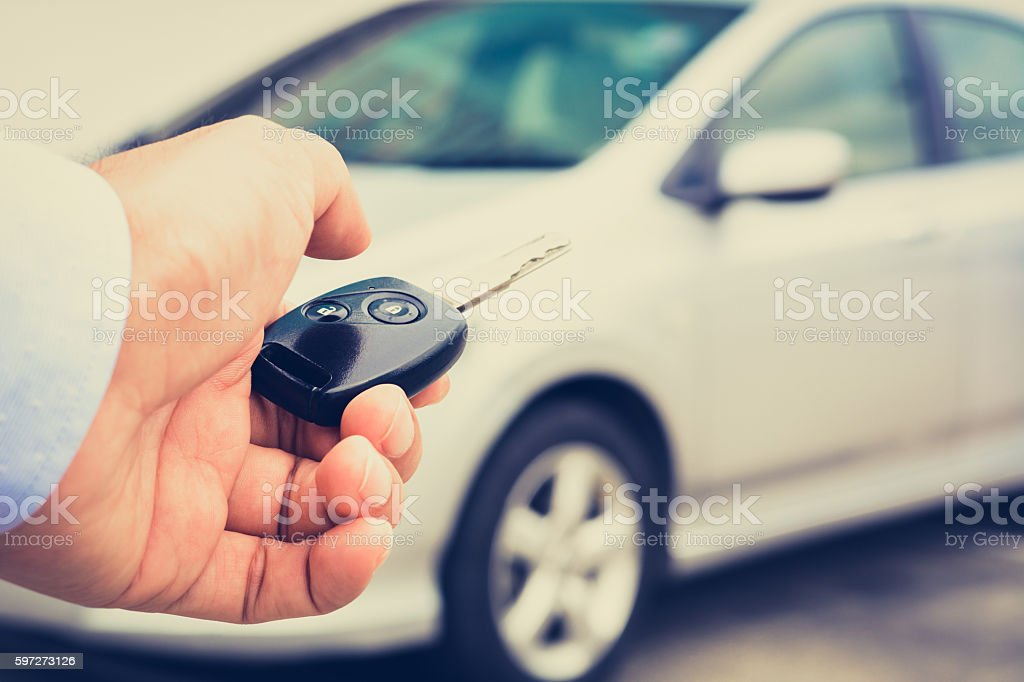 Hand about to press button of remote control car key royalty-free stock photo