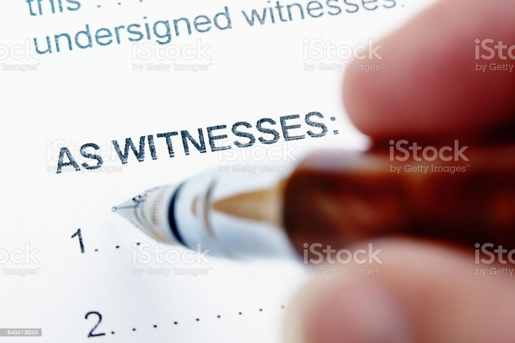 Hand about to sign as Witness on legal document stock photo