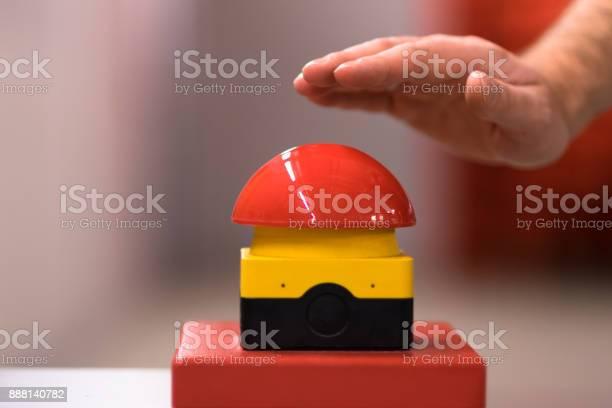 Hand above a red emergency button picture id888140782?b=1&k=6&m=888140782&s=612x612&h=hvrsoxdun xthlfyvneogfenpnzixgcqabqsodz9g5a=