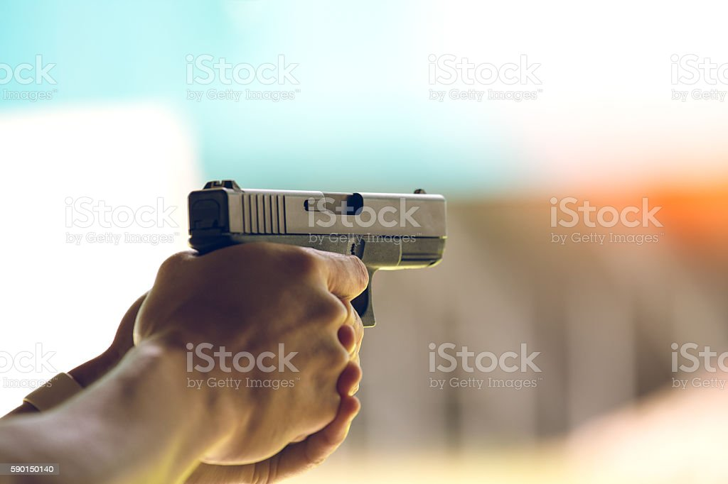 hand aim pistol in academy shooting range stock photo