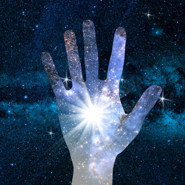 hand and abstract universe conceptual image of hand and abstract lights of universe. NASA galaxy images manipulated and used; https://nasasearch.nasa.gov/search/images?utf8=%E2%9C%93&affiliate=nasa&query=galaxy+images creation of the universe stock pictures, royalty-free photos & images
