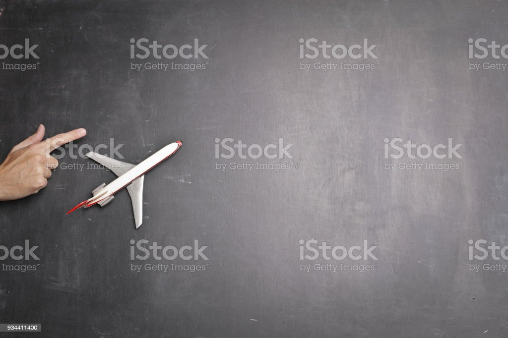 Hand and airplane toy stock photo