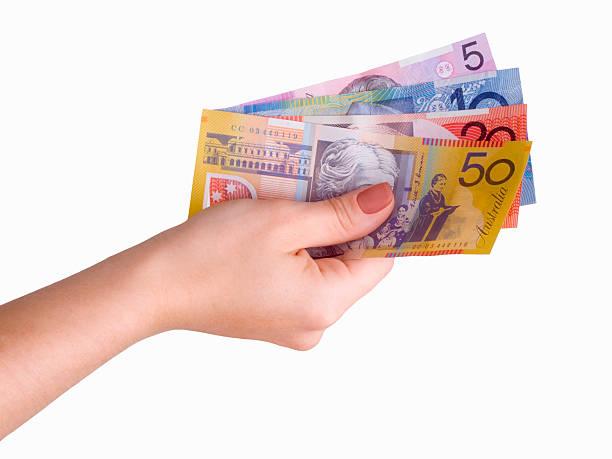 Hand and Australian Dollars stock photo