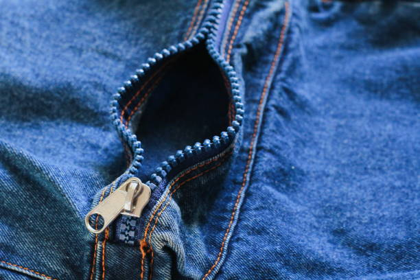 hand and blue jeans zip textile background. female vergina contraception concept - spermicide stock photos and pictures