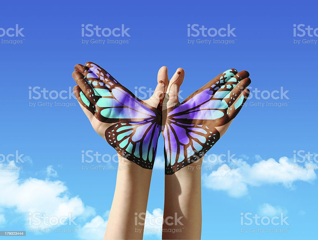 Hand and butterfly stock photo