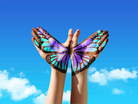 Hand And Butterfly Stock Photo - Download Image Now
