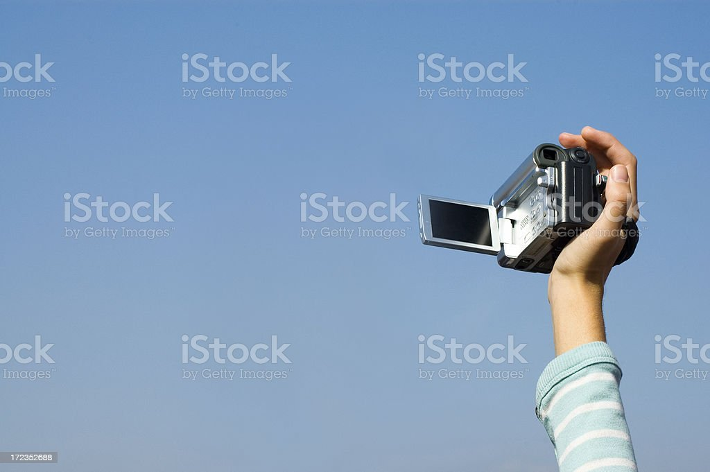 hand and camera royalty-free stock photo