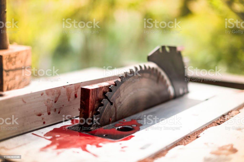 Steel cutting circular saw disc bloody, Safety first
