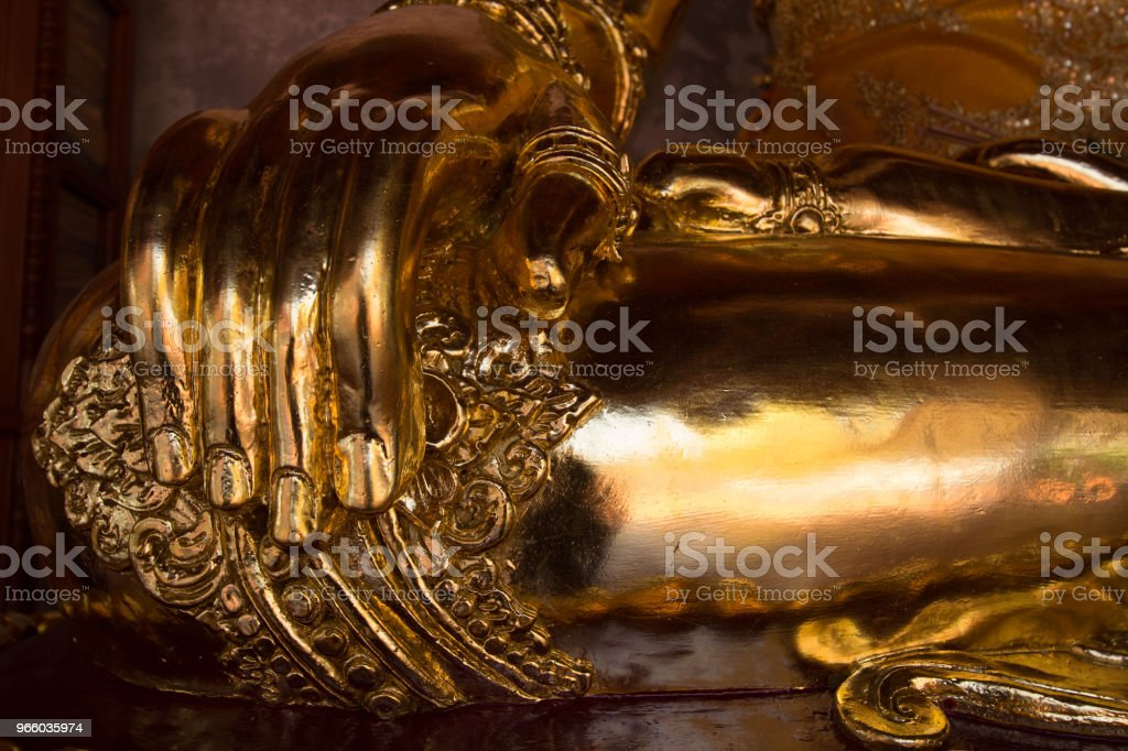 Hand and Fingers on Knee of Golden Buddha Statue - Royalty-free Beauty Stock Photo