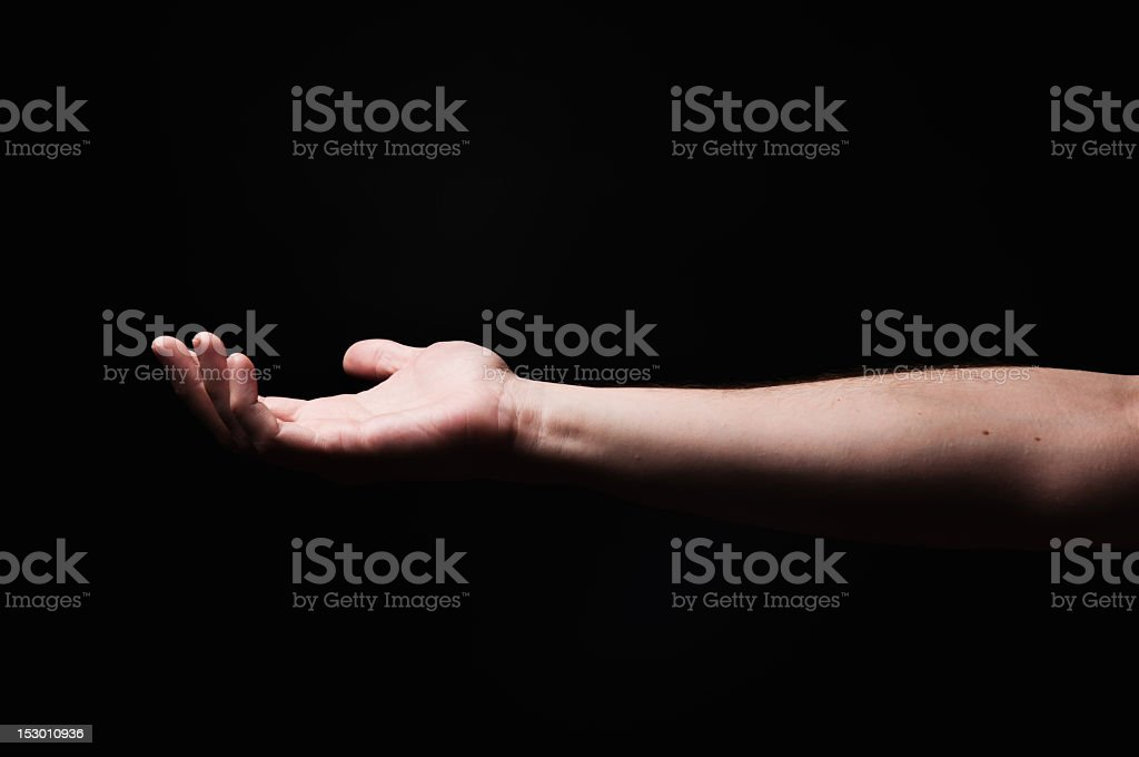 Hand and forearm up. Top illuminated. royalty-free stock photo