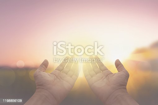 hand and jesus at sunrise nature background
