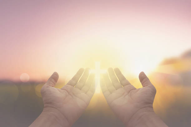 hand and jesus at sunrise nature background hand and jesus at sunrise nature background religion stock pictures, royalty-free photos & images