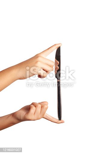 istock Hand and knife isolated on white background 1216031027