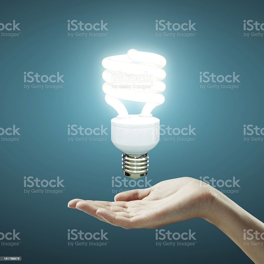 hand and  lamp stock photo