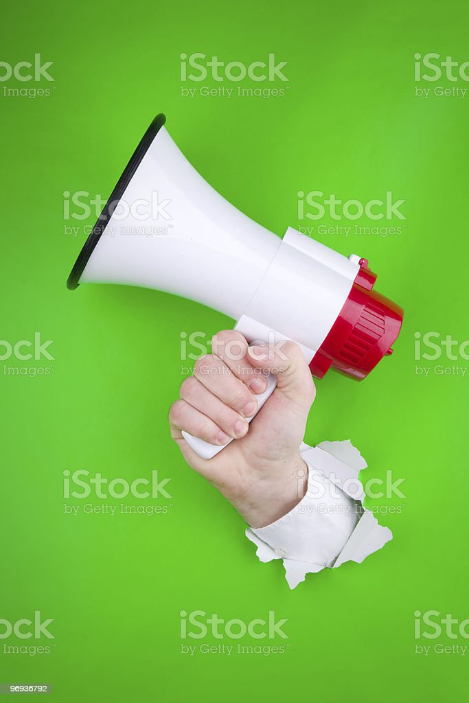 Hand and megaphone royalty-free stock photo