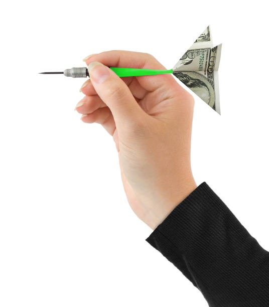 Hand and money darts stock photo