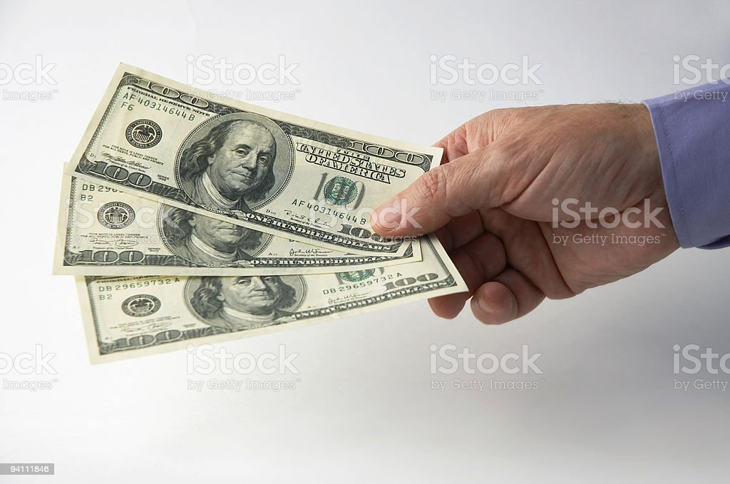 Hand and money royalty-free stock photo