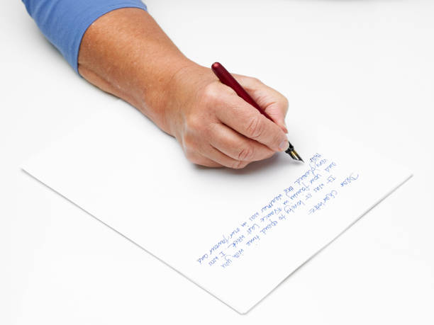 hand and pen stock photo