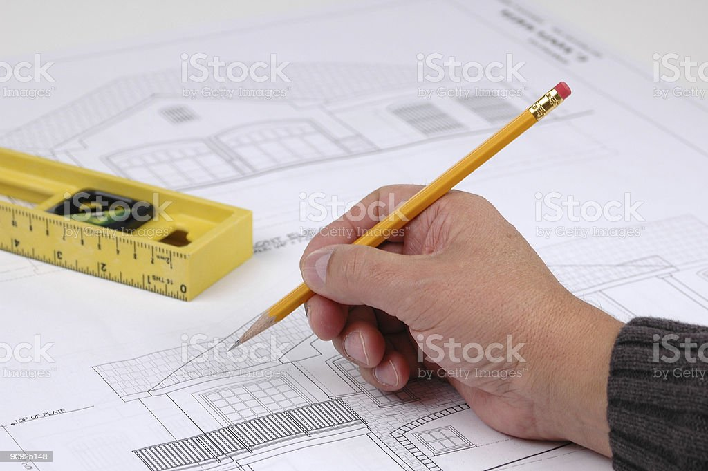 Hand and pencil on blue print royalty-free stock photo