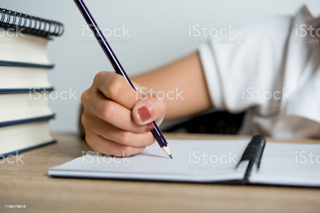 Hand and pencil pictures of students writing Education concept With...