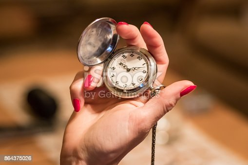 istock Hand and pocket watch 864375026