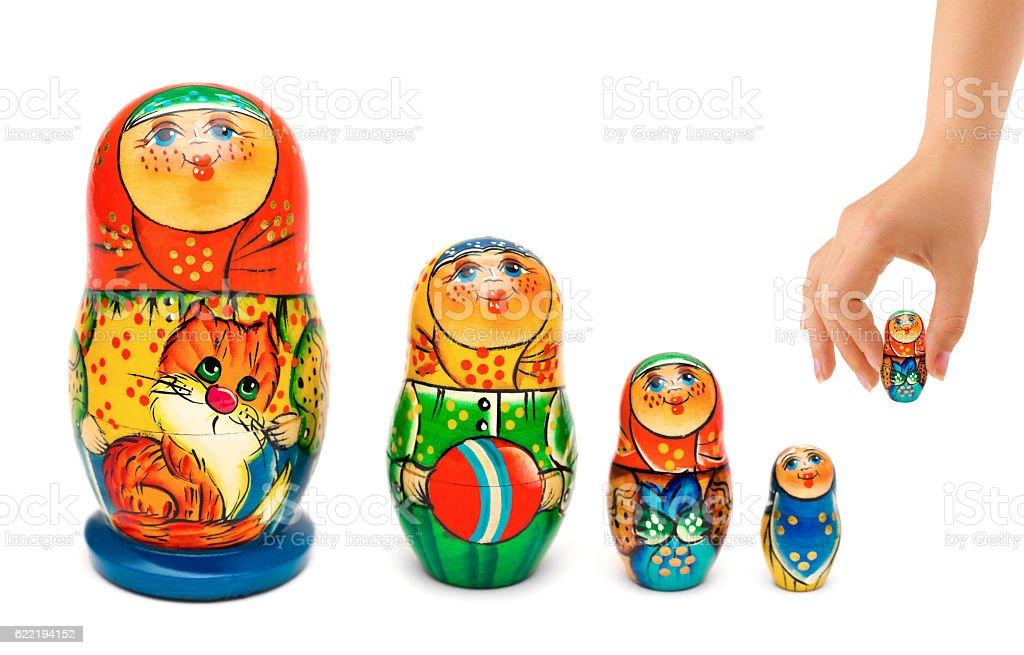 Hand and russian toy matrioshka stock photo