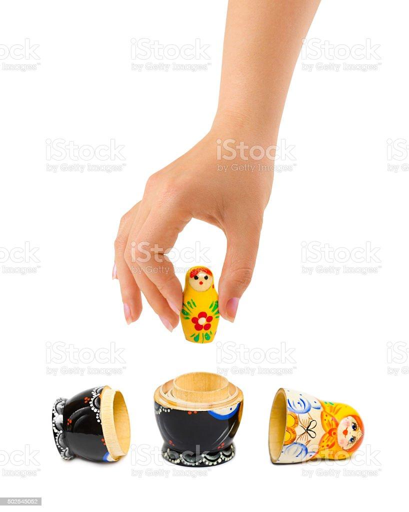Hand and russian toy matrioska stock photo