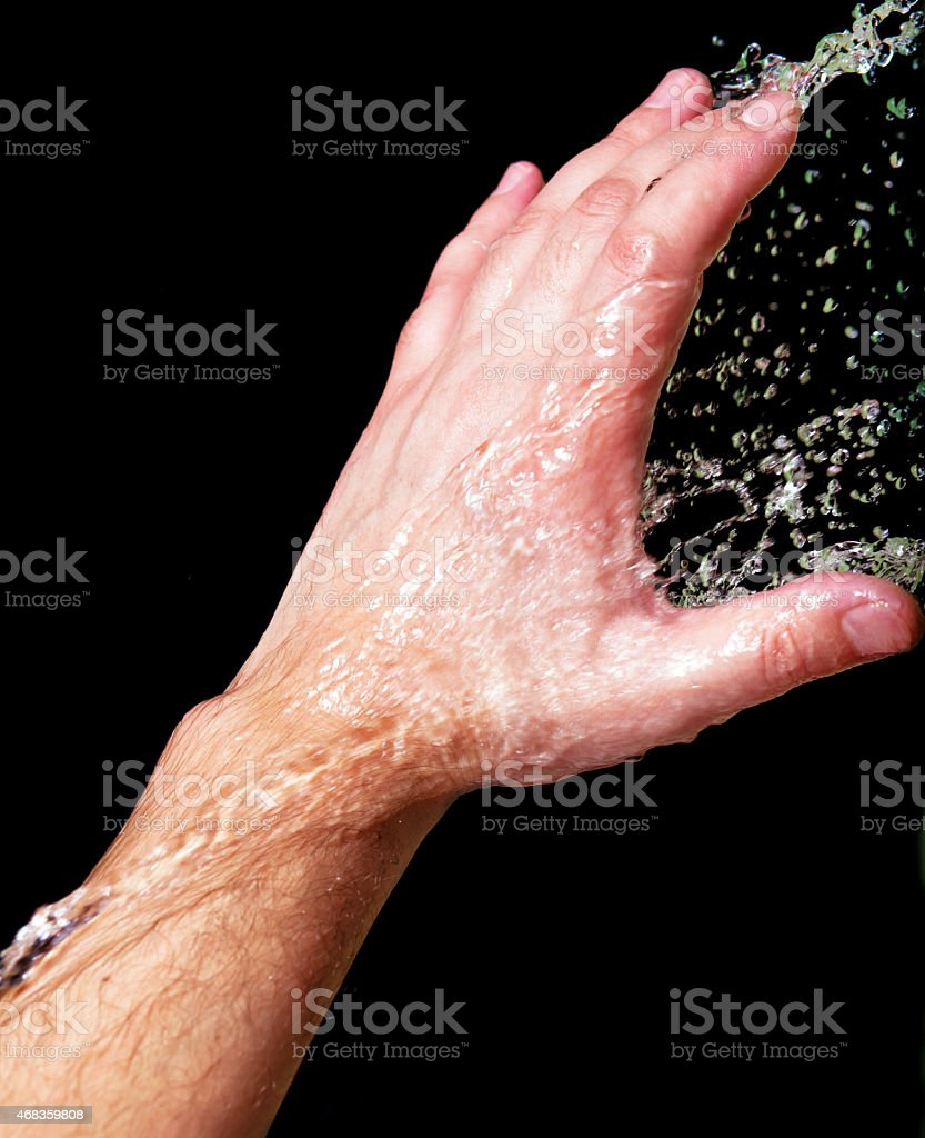 Hand and splashing water royalty-free stock photo