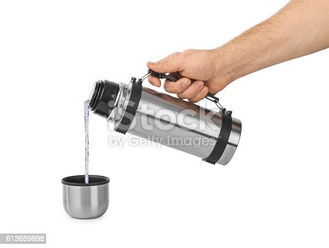 istock Hand and thermos flask 613689698