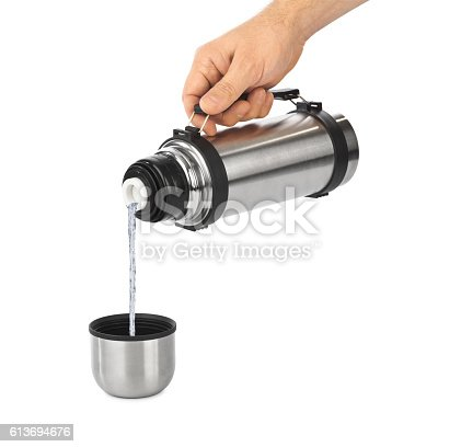 istock Hand and thermos flask 613694676