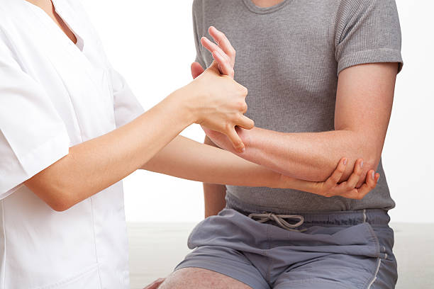 Hand and wrist examination stock photo