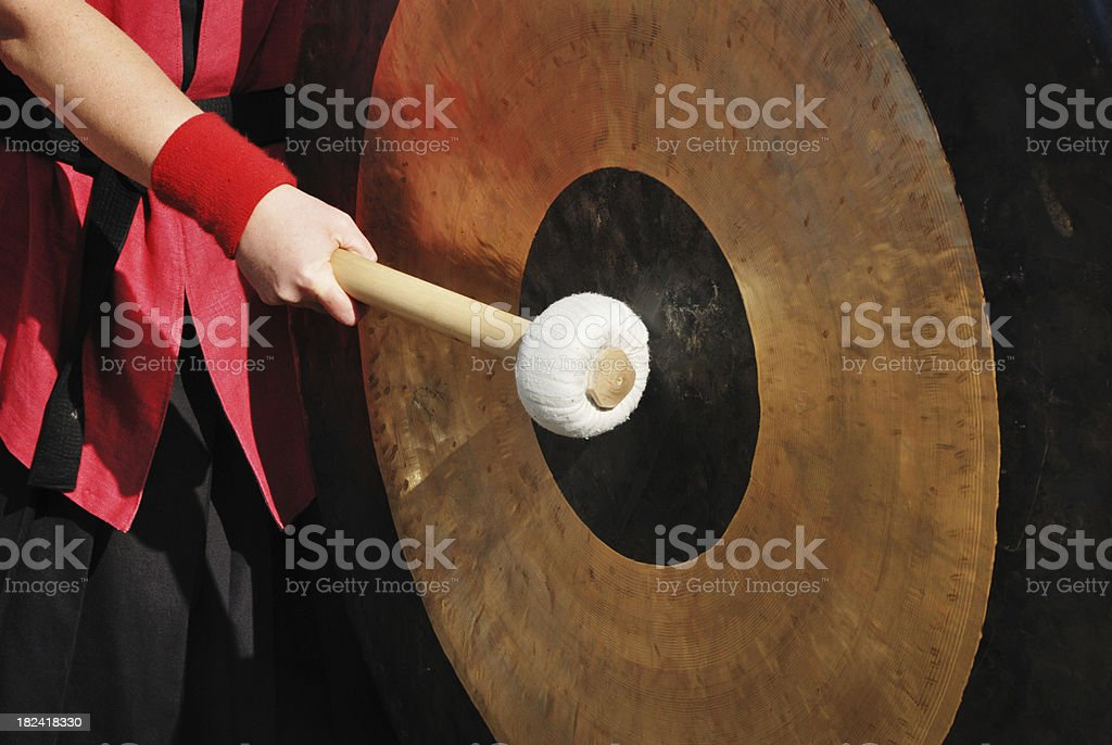 hand andjapanese gong stock photo
