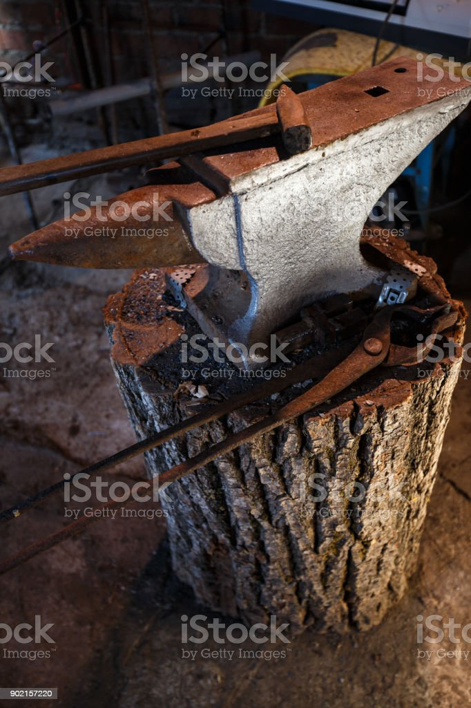 Hand anvil. Tools in old blacksmith shop stock photo